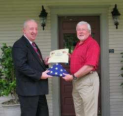 Howard Maxwell, Georgia State Representative, Chairman of the Retirement Committee, (Right) presenting the American Flag that was flown over the United States Capital, to Honor Lew Nason.