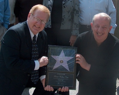 Wally Cato proudly displays his Hollywood Walk of Fame Star with Lew Nason